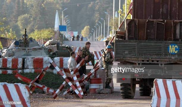 Russian soldiers look at the army track in the village of Ganmukhuri, leaving for Abkhazia on October 5, 2008. Georgian Interior ministry spokesman...