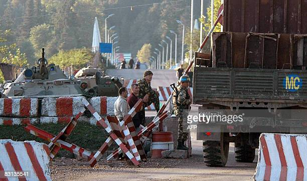 Russian soldiers look at the army track in the village of Ganmukhuri leaving for Abkhazia on October 5 2008 Georgian Interior ministry spokesman...