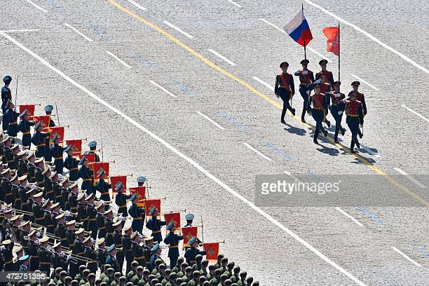 Russian soldiers march through Red Square during the Victory Day military parade in Moscow on May 9 2015 Russian President Vladimir Putin presides...