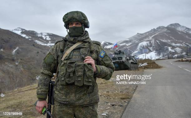 Russian soldiers of the peacekeeping force man a checkpoint on a road outside the town of Stepanakert on November 26 after six weeks of fighting...