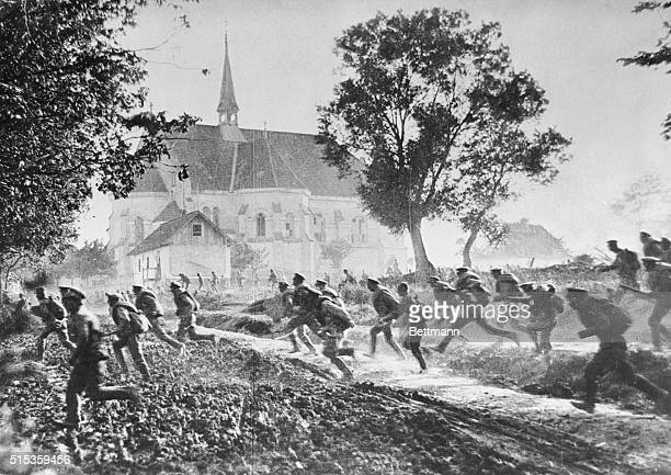Russian soldiers pass by a church while sprinting through fields during a battle in Ukraine's Galicia region during World War I