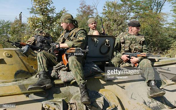 Russian soldiers patrol in Grozny Chechnya October 6 the day after elections confirmed Moscow's choice of Akhmad Kadyrov as president of the Chechen...