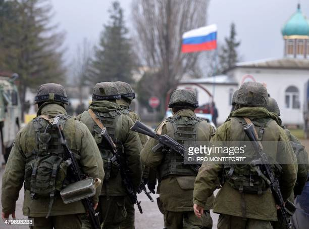 Russian soldiers patrol the area surrounding the Ukrainian military unit in Perevalnoye outside Simferopol on March 20 2014 Kiev will never recognise...
