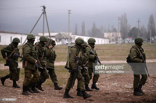 Russian soldiers patrol the area surrounding the Ukrainian military unit in Perevalnoye, outside Simferopol, on March 20, 2014. Kiev will never...