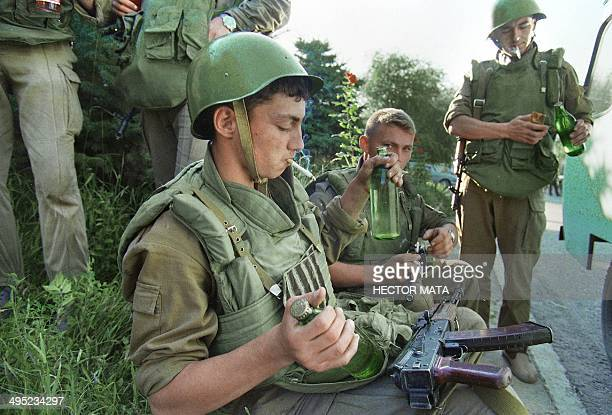 Russian soldiers rest after trying to take control of the hospital of the town of Budenovsk against Chechen rebels 17 June 1995 Just before the...