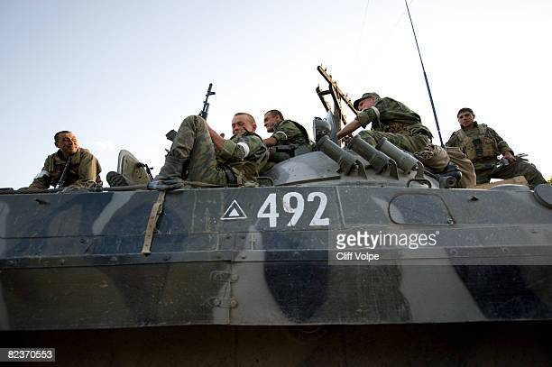 Russian soldiers rest on top of their military vehicles as the tense standoff on the north of Georgia continued on August 15 2008 in Igoleti Georgia...