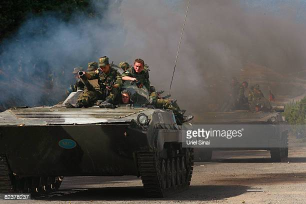 Russian soldiers ride an armoured personnel carrier on August 16 2008 in the village of Igoeti on the road from Gori to Tbilisi about 45 kilometres...