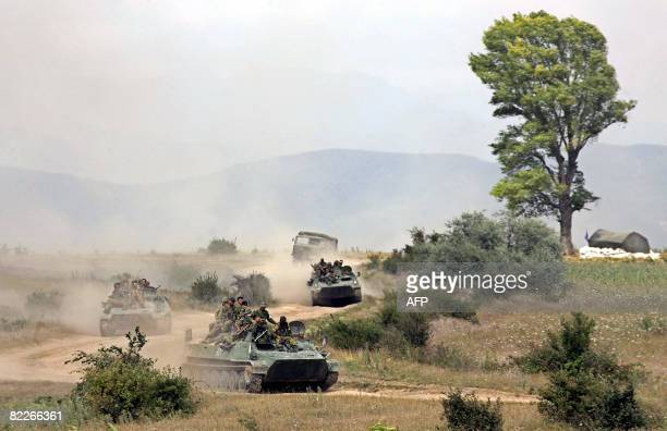Russian soldiers ride APCs outside the South Ossetia town of Tskhinvali on August 11 2008 Britain's Europe Minister Jim Murphy said Russia's military...