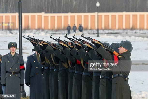 Russian soldiers shoot during the funeral ceremony for Mikhail Kalashnikov at the Federal Military Memorial Cemetery December 27 2013 in Mytishchi...