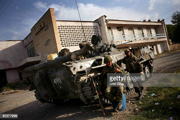 Russian soldiers sit by a tank at a Russian army position on August 16 2008 in the village of Igoeti on the road from Gori to Tbilisi about 45...