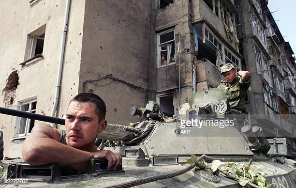 Russian soldiers sit in APC on August 12 2008 in the centre of Tskhinvali Russian and Georgian forces must pull back to the positions occupied prior...