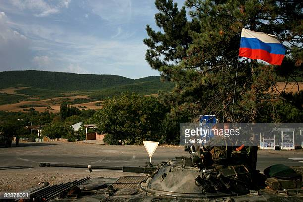 Russian soldiers sit on top of an armoured personell carrier flying the Russian flag at a Russian army position on August 16 2008 in the village of...