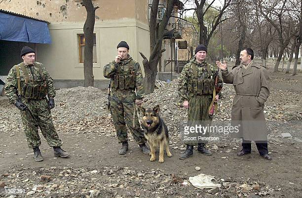 Russian soldiers stand guard November 22 2000 on a street near a proMoscow administration building in Chechnya Russia''s 14month occupation of...