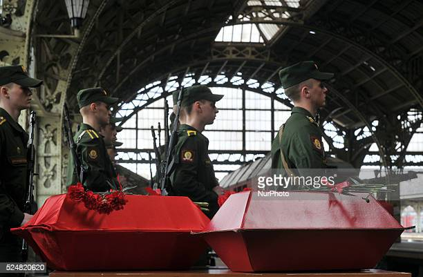 Russian soldiers take part in the meeting of the remains of Red Army soldiers who died in World War II in Ukraine came to the Vitebskij Station by...