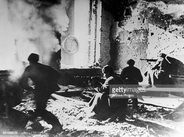 Russian soldiers target the Germans from within an abandoned building during the Battle of Stalingrad World War II circa 1942 The soldier in motion...
