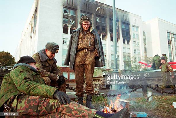 Russian soldiers wake up around a campfire the morning after Rutskoi and Khasbulatov surrender thus ending the Second Soviet Coup