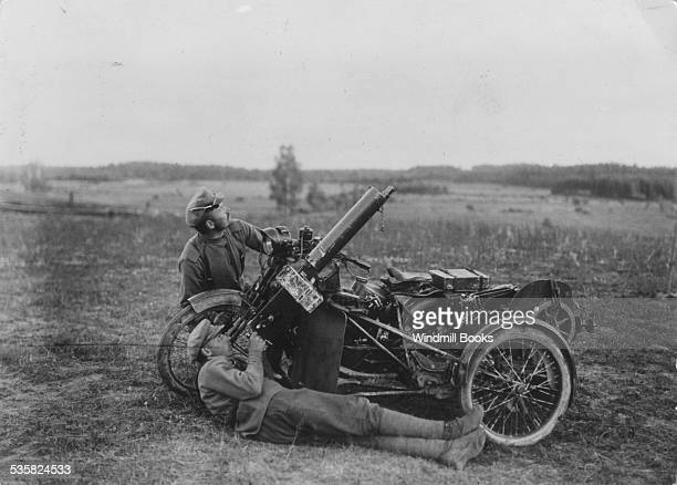 Russian Soldiers with an antiaircraft gun mounted on a motorcycle 1914