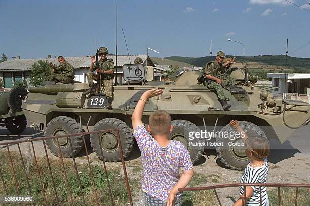 Russian soldiers with local children in Gnjilane near their HG