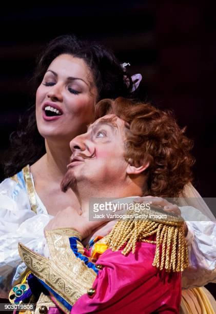 Russian soprano Anna Netrebko and Italian baritone Alessandro Corbelli perform during the final dress rehearsal of Act 2 of the Metropolitan...