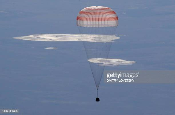 Russian Soyuz MS07 space capsule lands about 150 km southeast of the Kazakh town of Dzhezkazgan on June 3 2018 A Soyuz space capsule with Russian...