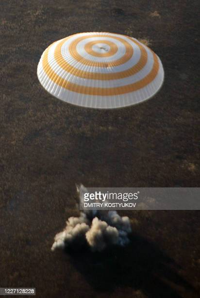 Russian Soyuz space capsule with cosmonauts Sergei Volkov and Oleg Kononenko and US space tourist Richard Garriott lands not far from the Kazakh town...