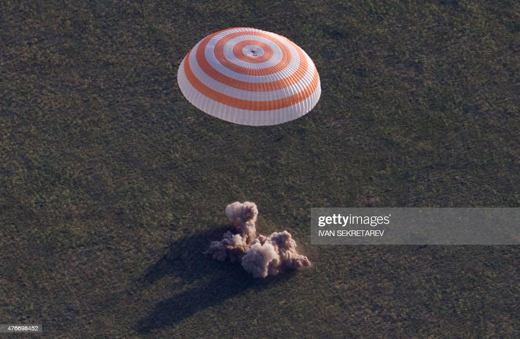 Russian Soyuz TMA-15M space capsule carrying the International Space Station (ISS) crew of Russian cosmonaut Anton Shkaplerov, U.S. astronaut Terry Virts and Italian astronaut Samantha Cristoforetti lands in a remote area outside the town of Dzhezkazgan, Kazakhstan, on June 11, 2015. A three-person crew from the International Space Station landed safely in the steppes of Kazakhstan on June 11 after a longer-than-expected orbital stint.