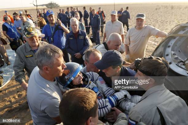 Russian space agency rescue team carries out US astronaut Peggy Whitson from Soyuz MS04 space capsule just before landing in a remote area outside...
