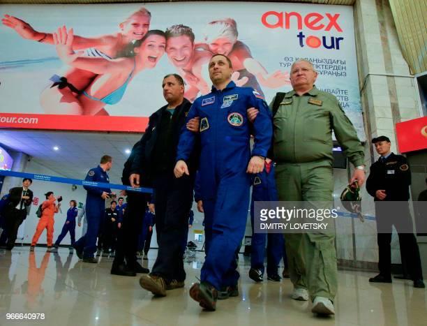 Russian space agency rescue team help Russian cosmonaut Anton Shkaplerov to walk after landing in the Russian Soyuz MS07 space capsule at Karaganda's...