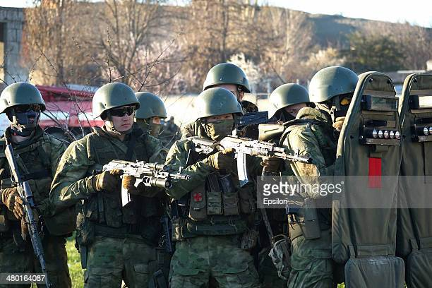 Russian special forces storm the Ukrainian Belbek Airbase on March 22 2014 near BELBEK CRIMEA Russian troops have seized control of Belbek Airbase...
