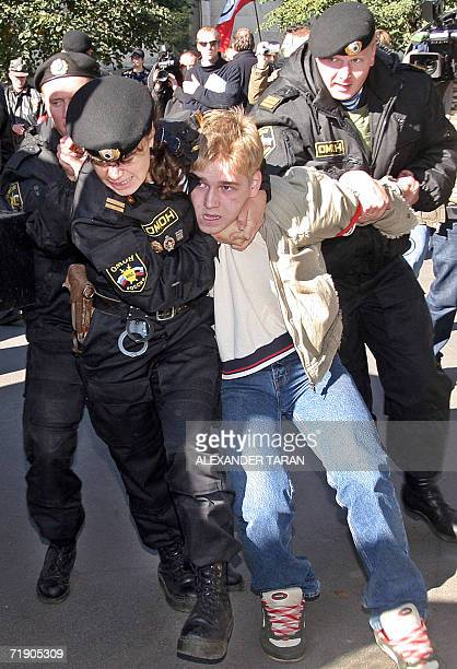 Russian special police forces arrest a Human Rights demonstrator during a rally to protest against the G8 Heads of Parliament summit in StPetersburg...