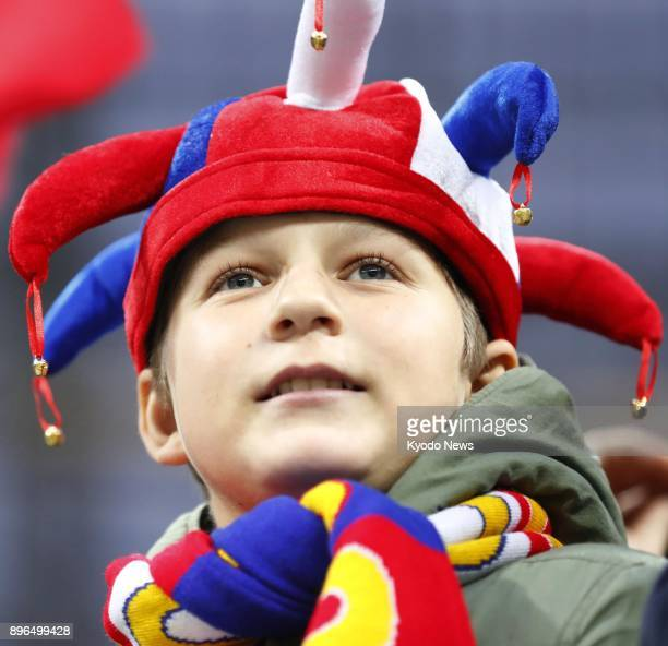 A Russian spectator watches a football friendly between Russia and Argentina at Luzhniki Stadium in Moscow on Nov 11 2017 The stadium is a venue of...