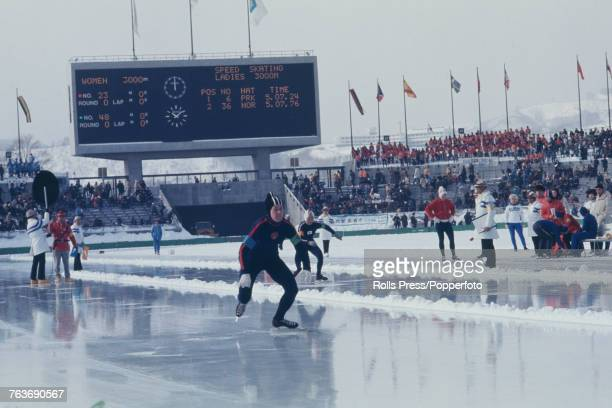 Russian speed skater Nina Statkevich of the Soviet Union team and Satomi Koike of the Japan team pictured in competition in the Women's 3000 metres...