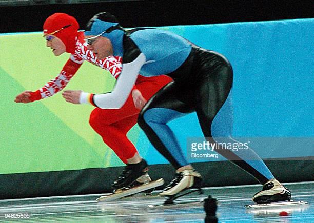 Russian speed skater Svetlana Zhurova left races against German Jenny Wolf in the 500 meter women's speed skating event which Zhurova went on to win...