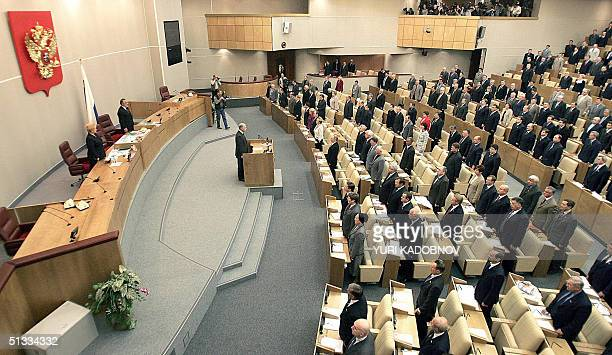 Russian State Duma deputies listen to the national anthem during a session in Moscow 22 September 2004 The autumn session of the State Duma opened...