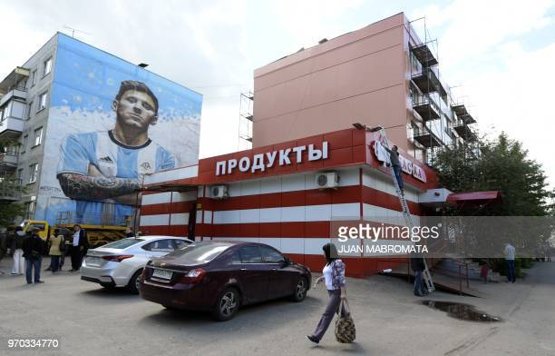 Russian street artist Sergey Erofeev's mural depicting Argentina's football star Lionel Messi is seen on the wall of a residential building in...