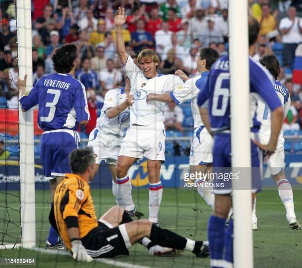 Russian Striker Dmitry Bulykin celebrates after scoring a goal despite of Greece's goalkeeper Antonios Nikopolidis , 20 June 2004 during their...