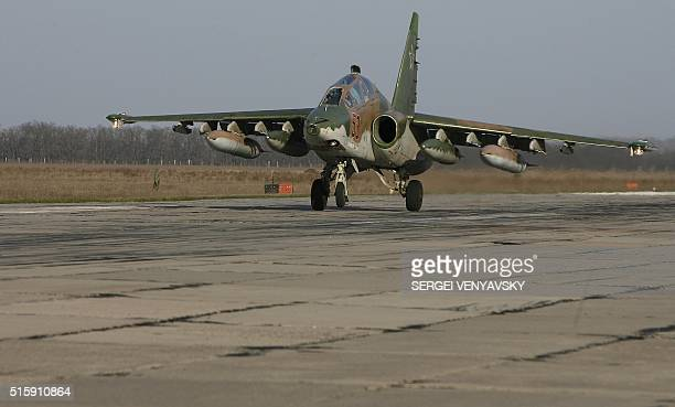 A Russian Su25 ground attack aircraft lands at an airbase in the southern Russia's Krasnodar region on March 16 as part of the withdrawal of Russian...