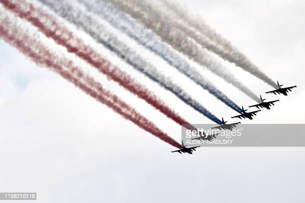 Russian Su25 jet fighters fly during the parade of the Russian fleet as part of the Navy Day celebration in Saint Petersburg on July 28 2019