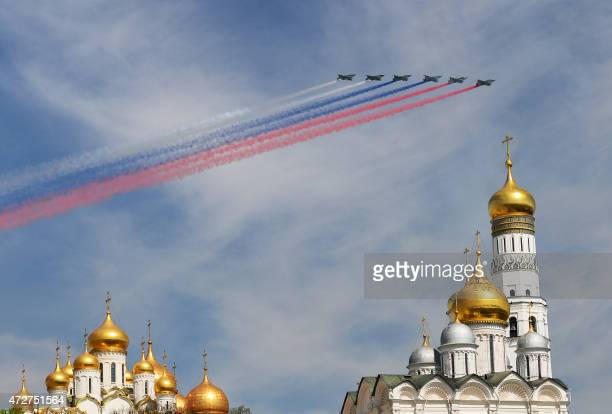 Russian Sukhoi Su25 Frogfoot groundattack planes fly over Red Square during the Victory Day military parade in Moscow on May 9 2015 Russian President...