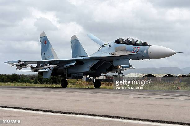 A Russian Sukhoi Su35 bomber lands at the Russian Hmeimim military base in Latakia province in the northwest of Syria on May 4 2016 Syria's conflict...