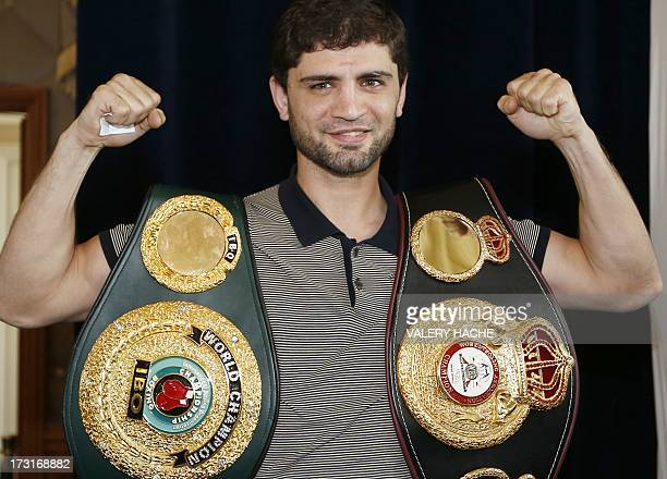 Russian super lightweight world title holder Khabib Allakhverdiev poses on July 9 2013 after a press conference in Monaco ahead of his July 13...