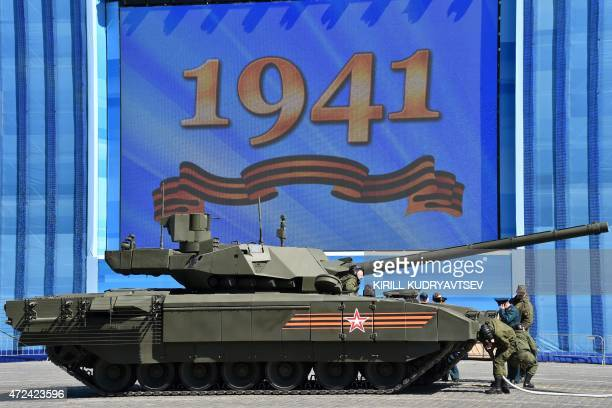 A Russian T 14 Armata tank is ready to be towed during a rehearsal for the Victory Day military parade on Moscow's Red Squre on May 7 2015 Russia...