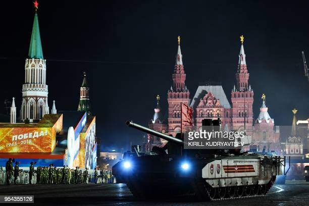 Russian T 14 Armata tanks ride through Red Square during the Victory Day military parade night rehearsal on May 3 2018 in Moscow Russia celebrates...