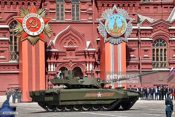 A Russian T14 Armata tank drives through Red Square during the Victory Day military parade in Moscow on May 9 2015 Russian President Vladimir Putin...
