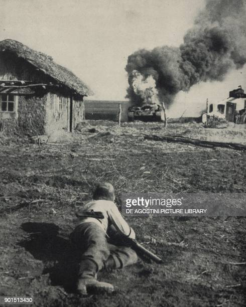 Russian T34 tank destroyed at close range by a German antitank rocket on the Eastern Front World War II photograph by GoettertTransocean from...