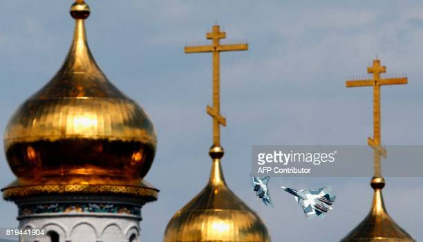 Russian T-50 fighters perform during exhibition flight on July 20, 2017 at the annual air show MAKS 2017 in Zhukovsky, some 40kms outside Moscow. /...