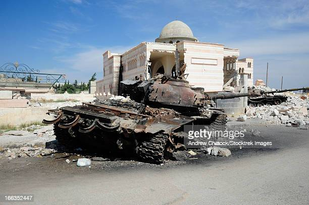 a russian t-72 main battle tank destroyed in azaz, syria. - syria stock pictures, royalty-free photos & images