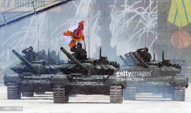 Russian T-72B3 tanks drive during the military parade marking the 75th anniversary of the lifting of the Nazi siege of Leningrad, at Dvortsovaya...