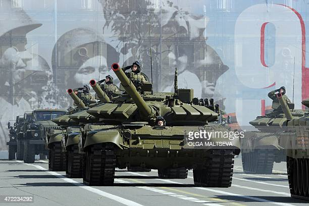 Russian T72B3 tanks roll across Dvortsovaya square in central Saint Petersburg on May 5 during a rehearsal of the Victory Day parade Russia will...