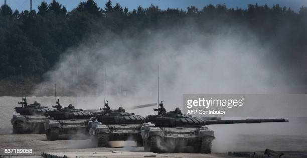 Russian T90 tanks take position before firing in Kubinka Patriot Park outside Moscow on August 22 2017 during the first day of the Army 2017...